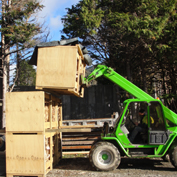 stacking the crates that store and dry seasoned firewood